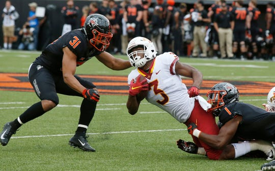Iowa State running back Kene Nwangwu (3) is tackled by Oklahoma State safety Kolby Peel (31) and linebacker Calvin Bundage (1) in the second half of an NCAA college football game in Stillwater, Okla., Saturday, Oct. 6, 2018.
