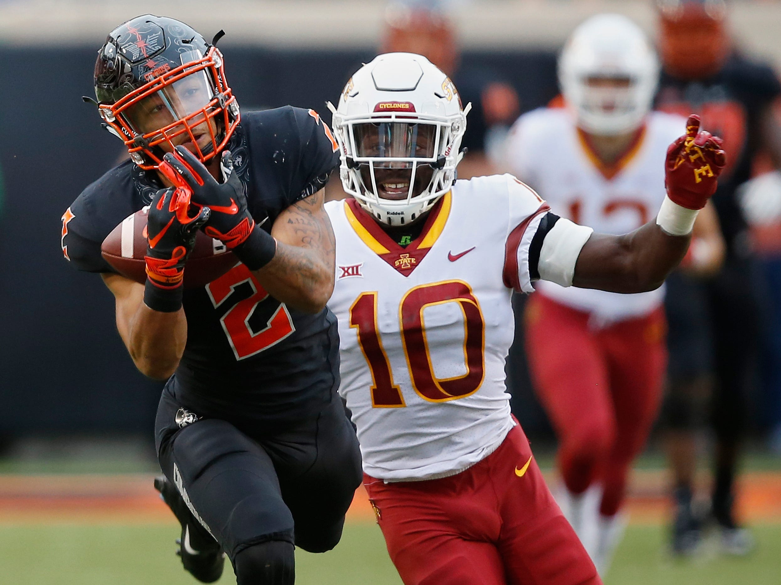 Oklahoma State wide receiver Tylan Wallace (2) can't hold onto the ball on a pass in front of Iowa State defensive back Brian Peavy (10) in the second half of an NCAA college football game in Stillwater, Okla., Saturday, Oct. 6, 2018.