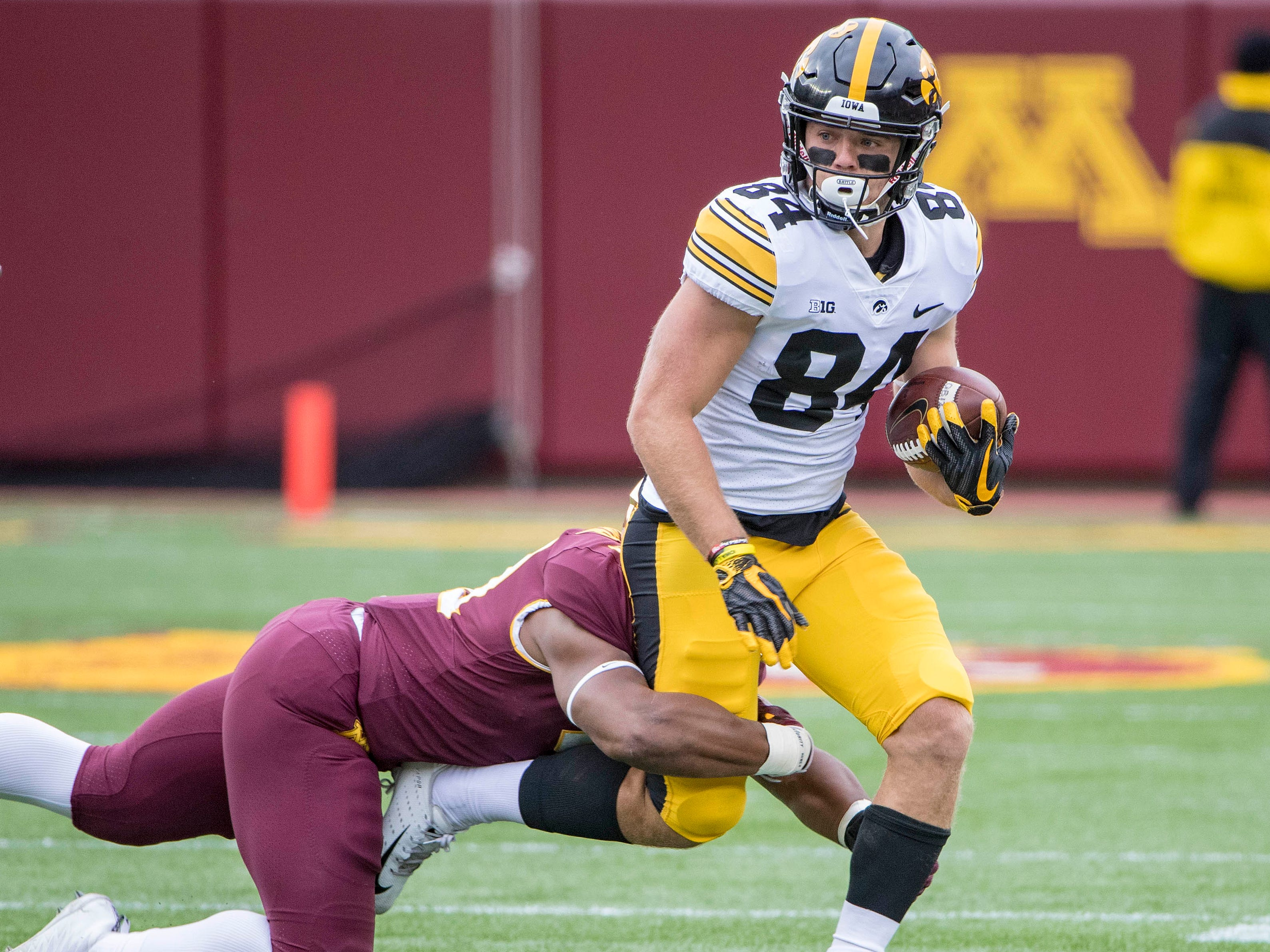 Oct 6, 2018; Minneapolis, MN, USA; Iowa Hawkeyes wide receiver Nick Easley (84) runs the ball after making a catch against Minnesota Golden Gophers linebacker Thomas Barber (41) in the first quarter at TCF Bank Stadium. Mandatory Credit: Jesse Johnson-USA TODAY Sports