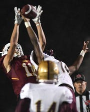 Ankeny's Brody Brecht (11) fights for a pass with Lincoln's Khalil Summerville (18) on Friday, Oct. 5, 2018 during a football game between the Ankeny Hawks and the Lincoln Railsplitters at Northview Middle Stadium.