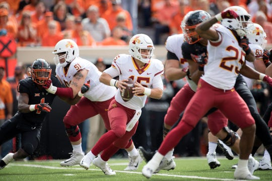 Oct 6, 2018; Stillwater, OK, USA; Iowa State Cyclones quarterback Brock Purdy (15) scrambles against the Oklahoma State Cowboys during the first quarter at Boone Pickens Stadium.