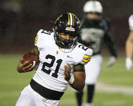 Southeast PolkRams Gavin Williams (21) runs the football against the Sioux City North Wolverines at Elwood Olsen Stadium. The Rams beat the Wolverines 77 to 6.