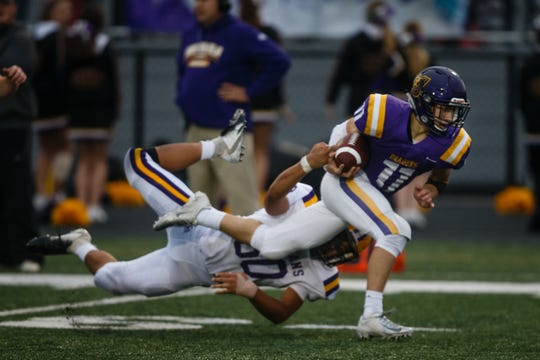 Indianola's Miles Berg (50) tries to tackle Johnston's Jordan Rusch (11) during their game at Johnston High School on Friday, Oct. 5, 2018 in Johnston.