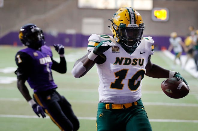 North Dakota State running back Lance Dunn (10) celebrates in front of Northern Iowa defensive back Roosevelt Lawrence, left, after catching a 3-yard touchdown pass during the first half of an NCAA college football game, Saturday, Oct. 6, 2018, in Cedar Falls, Iowa.