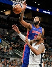 Detroit Pistons' Andre Drummond (0) shoots over San Antonio Spurs' LaMarcus Aldridge during the first half of an NBA preseason basketball game Friday, Oct. 5, 2018, in San Antonio.