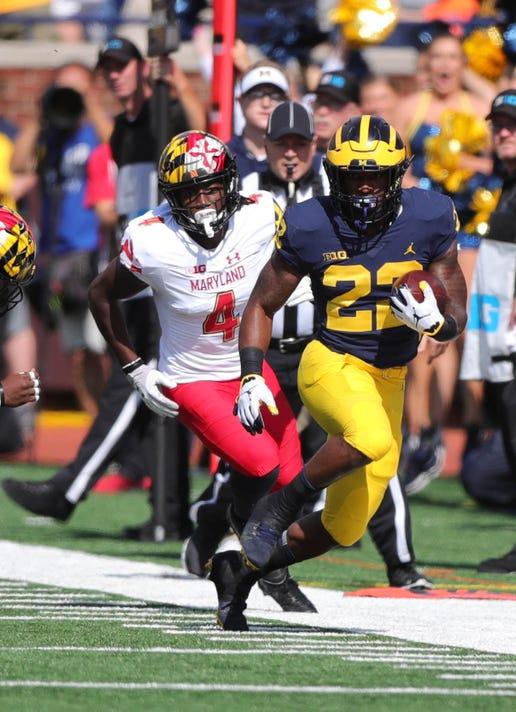 Michigans Karan Higdon Runs By Marylands Darnell Savage Jr During The First Half Saturday Oct   At Michigan Stadium In Ann Arbor