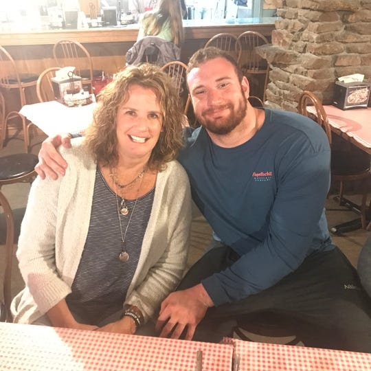 Lions rookie offensive lineman Frank Ragnow and his mother, Marty.
