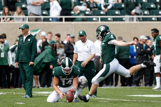 Michigan State kicker Matt Coghlin attempts a field goal as Brian Lewerke holds during warmups before the Northwestern game at Spartan Stadium in East Lansing, Saturday, Oct. 6, 2018.