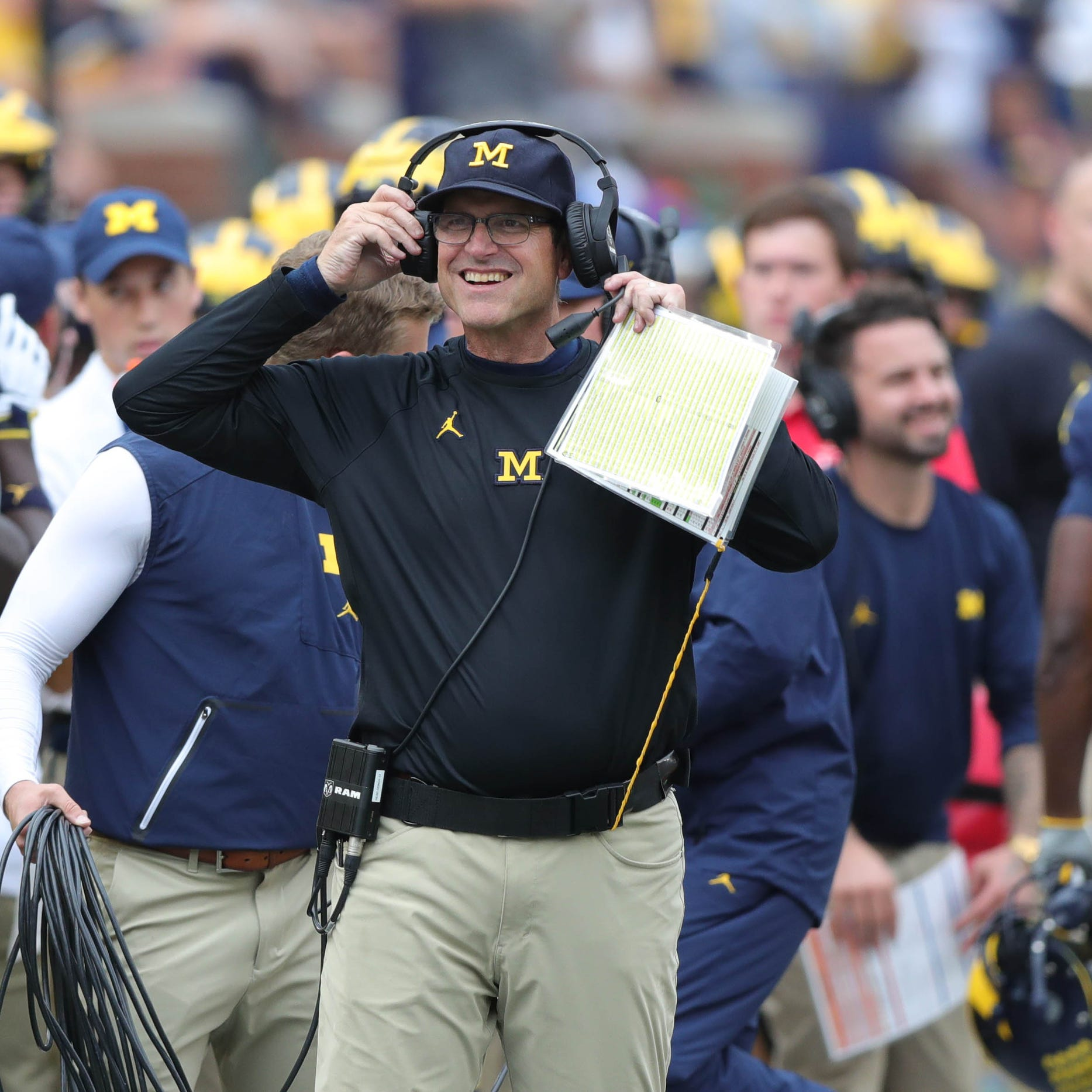 Michigan athletic director reiterates desire for Jim Harbaugh to never leave