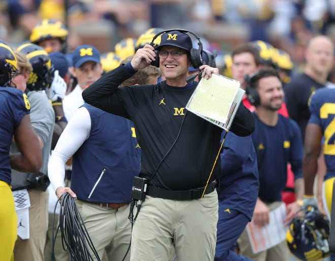 Michigan head coach Jim Harbaugh smiles on the sideline during the second half against Maryland, Saturday, Oct. 6, 2018 at Michigan Stadium.