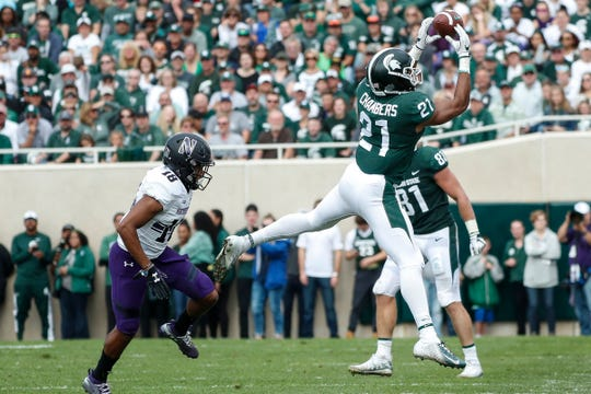 Michigan State receiver Cam Chambers makes a catch against Northwestern during the first half at Spartan Stadium in East Lansing, Saturday, Oct. 6, 2018.