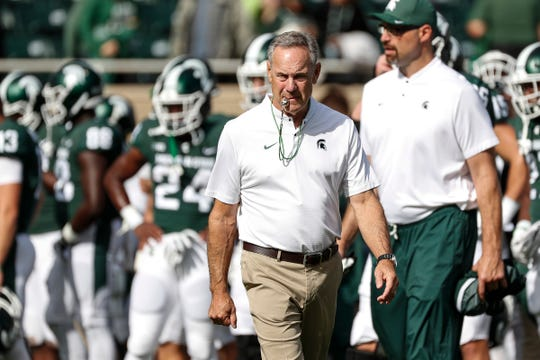 Mark Dantonio on Thursday reassigned Mark Staten, right, to tight ends coach after Staten coached Michigan State's offensive line since 2011. Dantonio also stripped Staten of his title as assistant head coach.