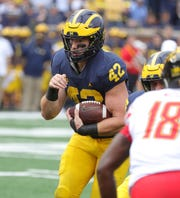 Michigan's Ben Mason runs in a two-point conversion against Maryland during the second half Saturday, Oct. 6, 2018 at Michigan Stadium.