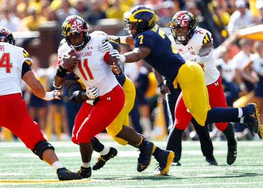 Maryland quarterback Kasim Hill is tackled by Michigan linebacker Khaleke Hudson in the first half in Ann Arbor, Saturday, Oct. 6, 2018.