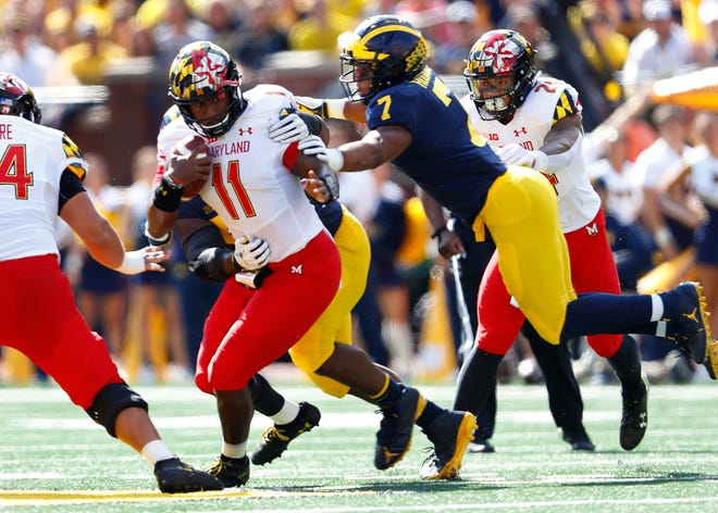 Maryland quarterback Kasim Hill is tackled by Michigan linebacker Khaleke Hudson in the first half in Ann Arbor, Saturday.