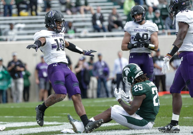 Northwestern safety JR Pace celebrates a play against Michigan State receiver Darrell Stewart Jr. during the second half at Spartan Stadium in East Lansing, Saturday, Oct. 6, 2018.