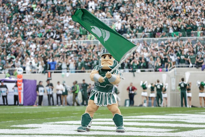 Michigan State mascot Sparty celebrates a touchdown against Northwestern during the second half at Spartan Stadium, Saturday, Oct. 6, 2018.