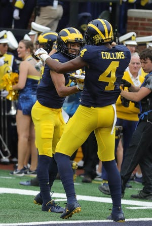 Michigan's Ronnie Bell (8) and Nico Collins celebrate after Bell scored a touchdown against Maryland during the first half Saturday, Oct. 6, 2018 at Michigan Stadium in Ann Arbor.