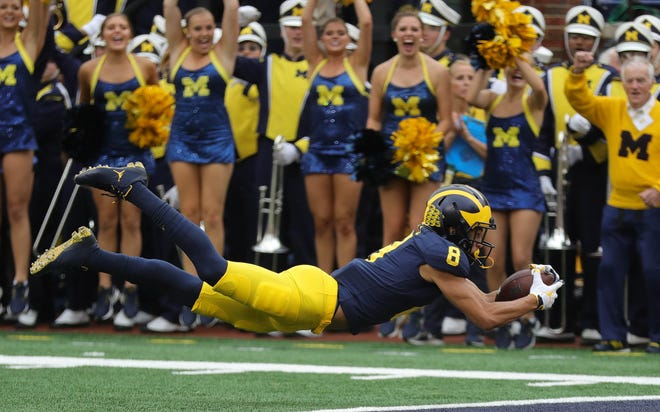 Michigan's Ronnie Bell dives for a touchdown against Maryland during the first half Saturday, Oct. 6, 2018 at Michigan Stadium.