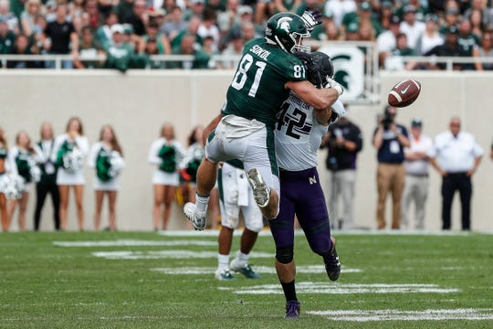Michigan State tight end Matt Sokol is defended by Northwestern linebacker Paddy Fisher during the second half at Spartan Stadium, Saturday, Oct. 6, 2018.