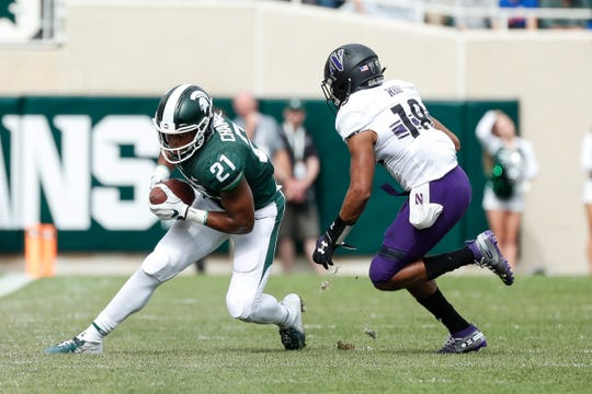 Michigan State receiver Cam Chambers is defended by Northwestern defensive back Cameron Ruiz during the second half at Spartan Stadium, Saturday, Oct. 6, 2018.