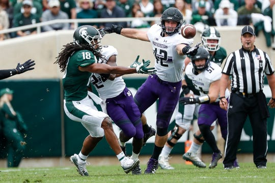 Michigan State receiver Felton Davis III and Northwestern linebacker Paddy Fisher battle for a pass during the first half at Spartan Stadium in East Lansing, Saturday, Oct. 6, 2018.