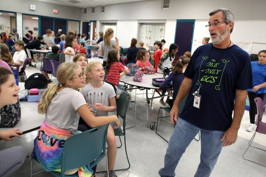 Fifth and sixth grade students joke around with lunch monitor Bob Fabry during lunch at Birmingham Covington School in Bloomfield Township on Thursday, October 4, 2018