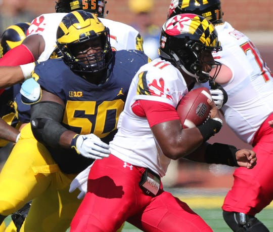 Michigan's Michael Dwumfour sacks Maryland's Kasim Hill during the first half Saturday, Oct. 6, 2018 at Michigan Stadium in Ann Arbor.