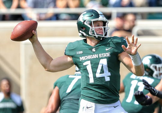 Michigan State quarterback Brian Lewerke passes during the first quarter against Northwestern at Spartan Stadium on Oct. 6, 2018 in East Lansing.