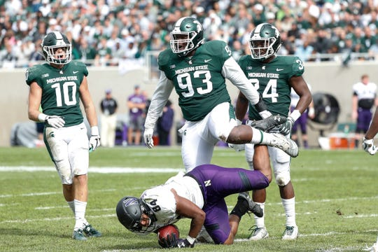 Michigan State defensive tackle Naquan Jones (93) celebrates a tackle against Northwestern's Cameron Green, but was called for an unsportsmanlike conduct penalty for stepping over Green, during the second half at Spartan Stadium, Saturday, Oct. 6, 2018.
