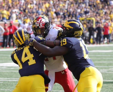 Michigans Josh Metellus  And Kwity Paye Stop Marylands Ty Johnson Short Of The