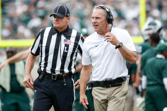 Michigan State head coach Mark Dantonio talks to a referee during the second half of the 29-19 loss to Northwestern at Spartan Stadium, Saturday, Oct. 6, 2018.
