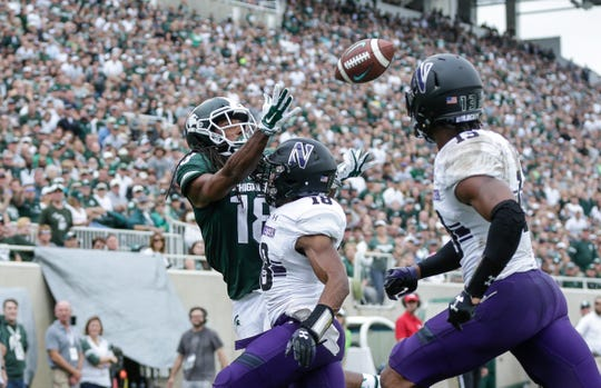 Michigan State receiver Felton Davis III catches a touchdown over Northwestern defensive back Cameron Ruiz (18) during the second half at Spartan Stadium, Saturday, Oct. 6, 2018.