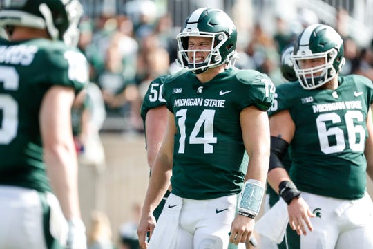 Michigan State quarterback Brian Lewerke reacts after a play against Northwestern during the first half at Spartan Stadium in East Lansing, Saturday, Oct. 6, 2018.