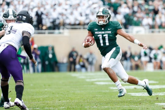 Michigan State running back Connor Heyward runs against Northwestern during the first half at Spartan Stadium in East Lansing, Saturday, Oct. 6, 2018.