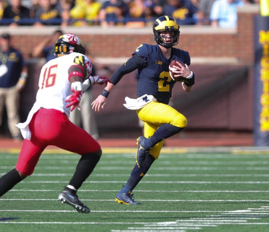 Michigan's Shea Patterson runs for a first down against Maryland during the second half Saturday, Oct. 6, 2018 at Michigan Stadium in Ann Arbor.