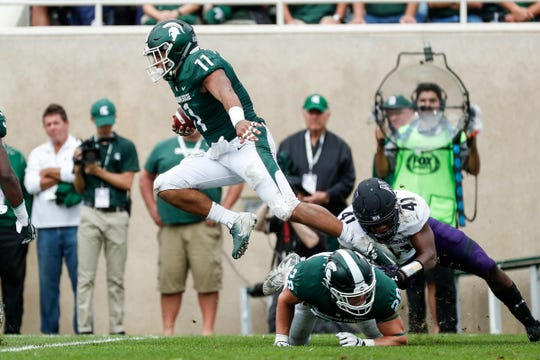 Michigan State running back Connor Heyward jumps as he returns a kick against Northwestern during the first half at Spartan Stadium in East Lansing, Saturday, Oct. 6, 2018.