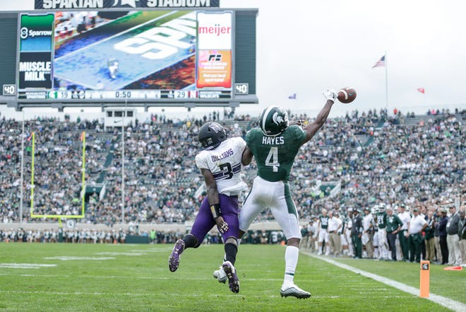 Michigan State receiver C.J. Hayes fails to make a catch against Northwestern cornerback Trae Williams during the second half at Spartan Stadium, Saturday, Oct. 6, 2018.