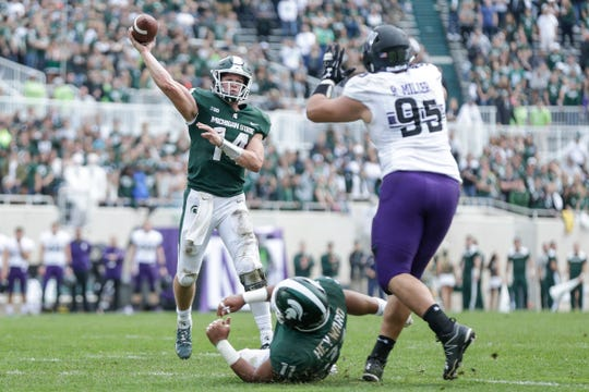 Michigan State quarterback Brian Lewerke passes against Northwestern during the second half at Spartan Stadium, Saturday, Oct. 6, 2018.