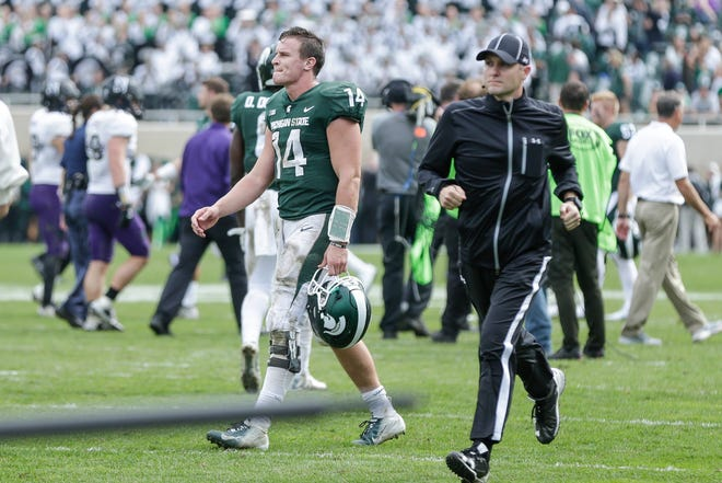 Michigan State quarterback Brian Lewerke walks off the field after the Spartans lost 29-19 to Northwestern at Spartan Stadium, Saturday, Oct. 6, 2018.