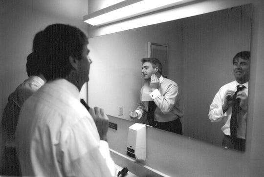 Rich Fisher shares the makeup mirror with Joe Glover