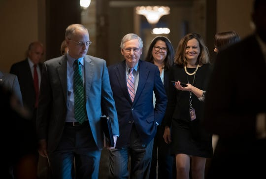 Senate Majority Leader Mitch McConnell, R-Ky., and his staff walk to the chamber for the final vote to confirm Supreme Court nominee Brett Kavanaugh, at the Capitol in Washington, Saturday, Oct. 6, 2018.