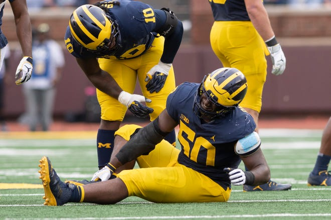 Michigan defensive lineman Michael Dwumfour was injured and left the game in the second quarter.