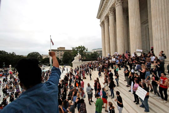 Activists protest on the steps of the Supreme Court after the confirmation vote of Supreme Court nominee Brett Kavanaugh, on Capitol Hill, Saturday, Oct. 6, 2018 in Washington.