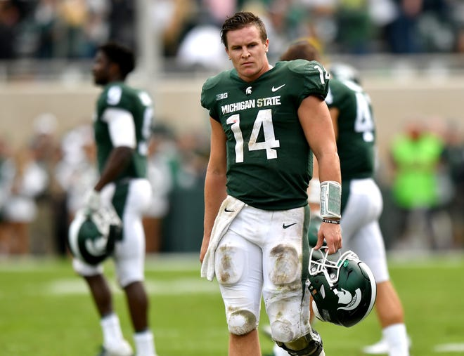 A discouraged Brian Lewerke walks off the field after MSU fell to Northwestern, 29-19, on homecoming weekend.