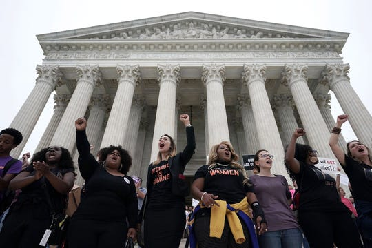 Activists occupy the front steps of the U.S. Supreme Court to protest against the confirmation of Judge Brett Kavanaugh to the Supreme Court October 6, 2018 in Washington, D.C.