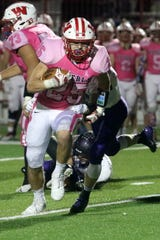 David Hallett picks up yardage for Waverly in a 30-14 victory over Dryden on Oct. 5, 2018 at Waverly Memorial Stadium.