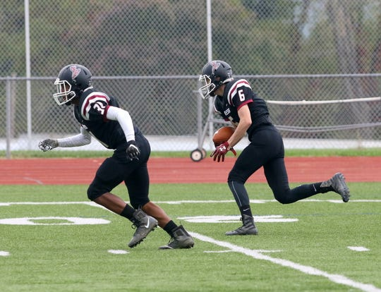 Elmira's Ryan Gerow returns an interception for a touchdown as Shamar Greene blocks during the Express' 64-7 victory over Ithaca on Oct. 6, 2018 at Ernie Davis Academy.