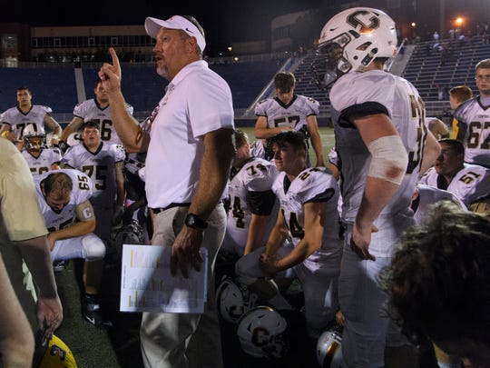 Central Head Coach Troy Burgess tells the team he will see them at practice on Tuesday after their 42-7 victory over the Mater Dei Wildcats at the Reitz Bowl in Evansville, Ind., Friday, Oct. 5, 2018. The Bears defeated the Wildcats, 42-7.