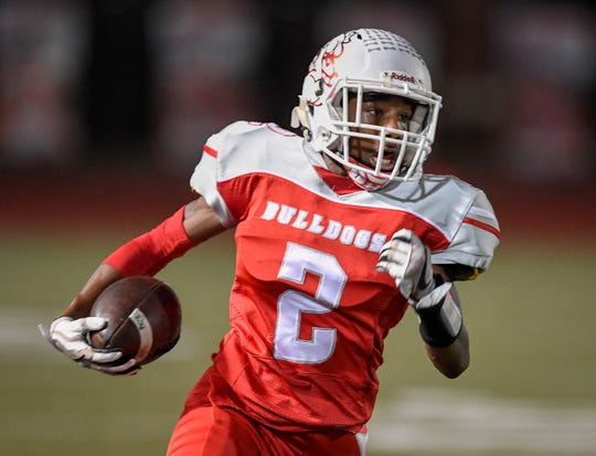 Bosse's Tashmond Starks (2) picks up big yards as the Reitz Panthers play the Bosse Bulldogs at Enlow Field Friday, October 5, 2018.
